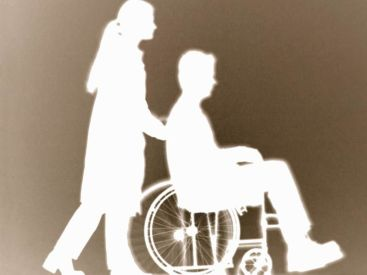 Ombra di caregiver e disabile